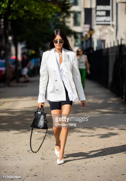 A guest is seen wearing white blazer cycle pants black bag outside Dion Lee during New York Fashion Week September 2019 on September 11 2019 in New...
