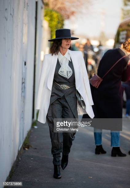 A guest is seen wearing white blazer grey overall outside Alberta Ferretti during Milan Fashion Week Fall/Winter 20202021 on February 19 2020 in...
