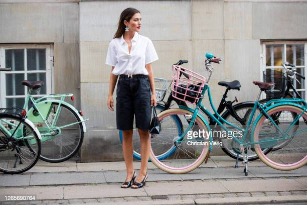 Guest is seen wearing white blouse, black Hermes black shorts outside Selected during Copenhagen Fashion Week Spring/Summer 2021 on August 12, 2020...