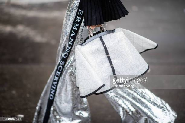 A guest is seen wearing white Chanel bag outside Stephane Rolland during Haute Couture Spring Summer 2019 Day Two on January 22 2019 in Paris France