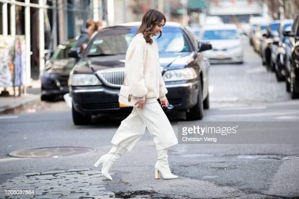 Guest is seen wearing white cropped ants outside Tibi during New York Fashion Week Fall/Winter 20 on February 08, 2020 in New York City.