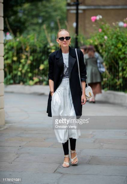 Guest is seen wearing white cropped pants, black blazer outside Erdem during London Fashion Week September 2019 on September 16, 2019 in London,...
