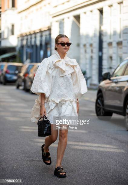Guest is seen wearing white dress, black bag, black sandals outside Malaikaraiss during Copenhagen Fashion Week SS21 on August 10, 2020 in...