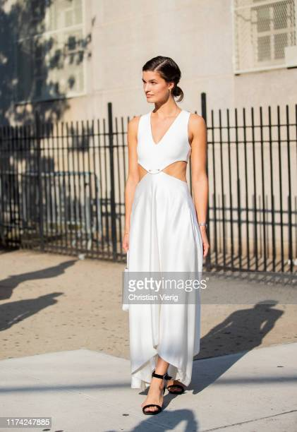 A guest is seen wearing white dress black heels outside Dion Lee during New York Fashion Week September 2019 on September 11 2019 in New York City