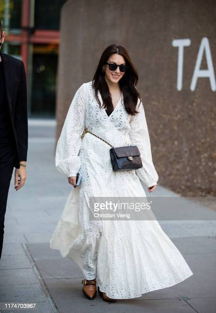 Guest is seen wearing white dress, Chanel bag outside Ports 1961 during London Fashion Week September 2019 on September 14, 2019 in London, England.