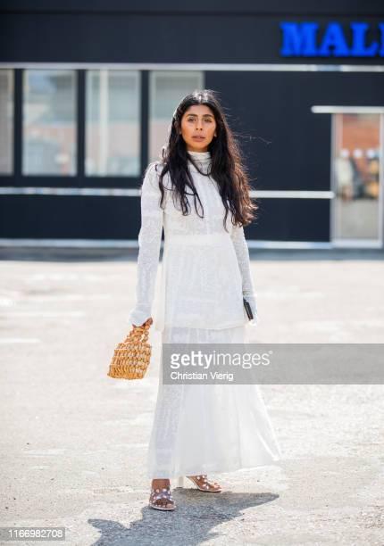 Guest is seen wearing white dress outside By Malene Birger during Copenhagen Fashion Week Spring/Summer 2020 on August 08, 2019 in Copenhagen,...