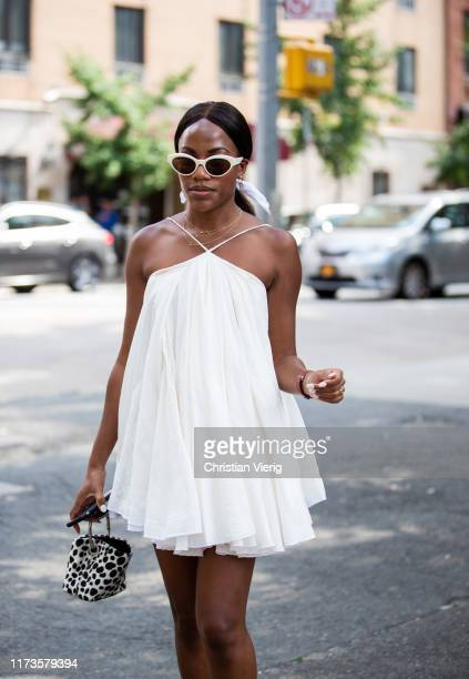 Guest is seen wearing white dress outside Maryam Nassir Zadeh during New York Fashion Week September 2019 on September 09, 2019 in New York City.