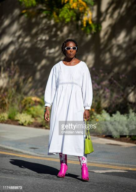 A guest is seen wearing white dress outside Preen during London Fashion Week September 2019 on September 15 2019 in London England