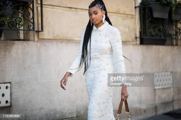 A guest is seen wearing white dress utside Dries van Noten during Paris Fashion Week Womenswear Fall/Winter 2019/2020 on February 27 2019 in Paris...