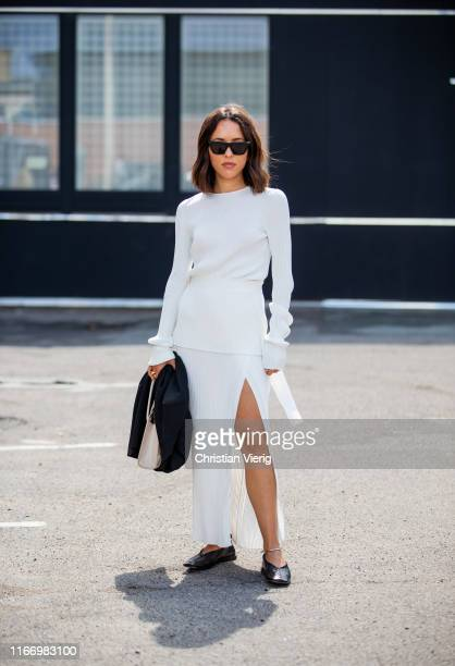 A guest is seen wearing white long shirt skirt with slit outside By Malene Birger during Copenhagen Fashion Week Spring/Summer 2020 on August 08 2019...