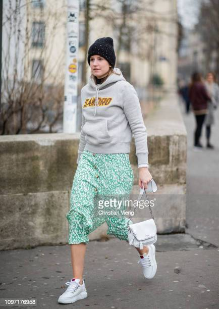 Guest is seen wearing white Nubikk bag outside Acne during Paris Fashion Week - Menswear F/W 2019-2020 Day Six on January 20, 2019 in Paris, France.
