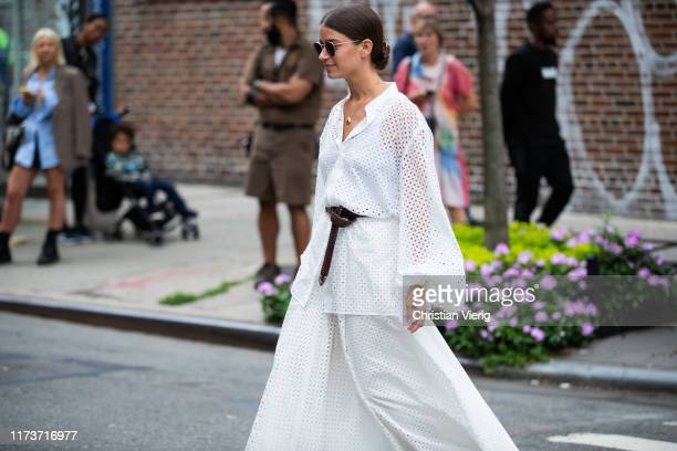 Guest is seen wearing white sheer button shirt, belt, skirt outside Gabriela Hearst during New York Fashion Week September 2019 on September 10, 2019...