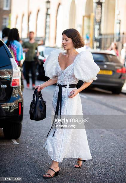 Guest is seen wearing white sheer dress outside Molly Goddard during London Fashion Week September 2019 on September 14, 2019 in London, England.