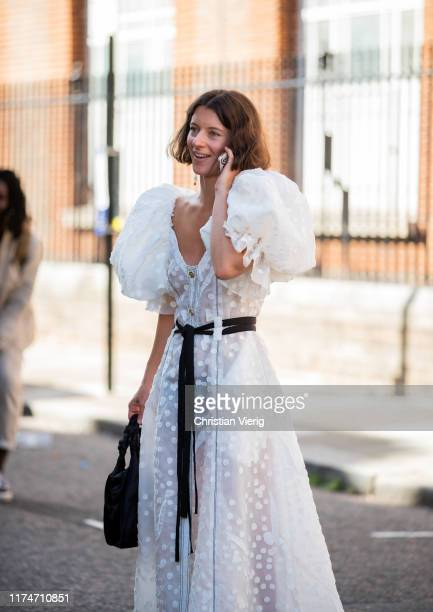 A guest is seen wearing white sheer dress outside Molly Goddard during London Fashion Week September 2019 on September 14 2019 in London England