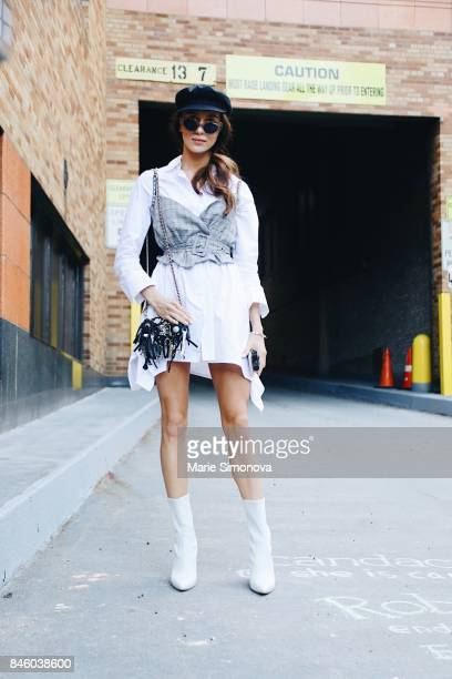 A guest is seen wearing white shirt grey top and black hat during New York Fashion Week on September 11 2017 in New York City