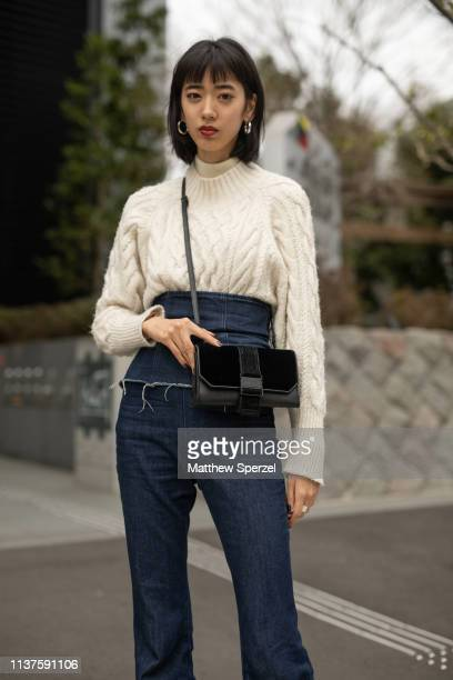 Guest is seen wearing white sweater, denim high waisted jeans, black bag during the Amazon Fashion Week TOKYO 2019 A/W on March 22, 2019 in Tokyo,...