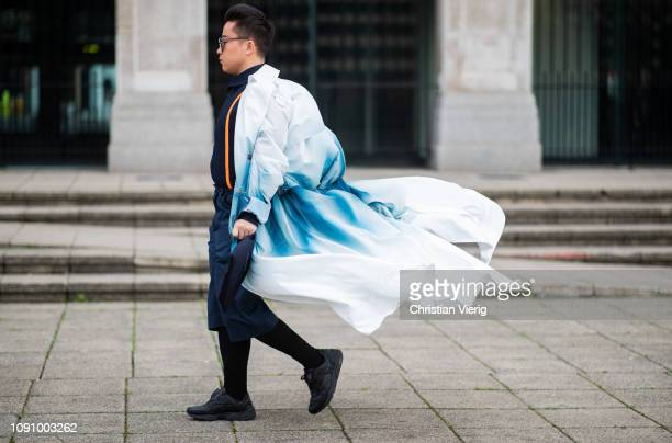 A guest is seen wearing white trench coat during London Fashion Week Men's January 2019 on January 07 2019 in London England