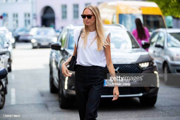 Guest is seen wearing white tshirt, black pants outside Skall Studio during Copenhagen Fashion Week Spring/Summer 2021 on August 12, 2020 in...