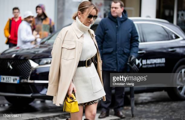 Guest is seen wearing white turtleneck knit worn as a dress, coat, yellow Loewe bag outside Altuzarra during Paris Fashion Week - Womenswear...