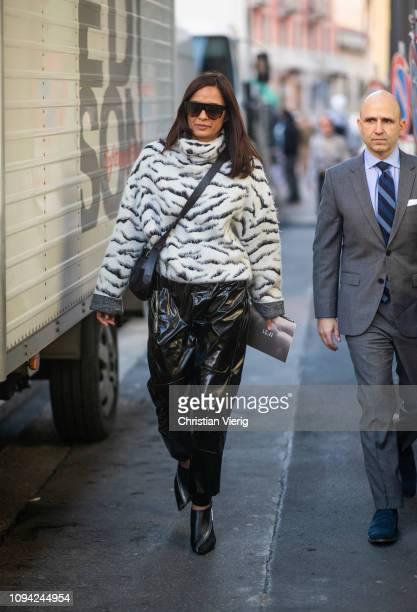 Guest is seen wearing wite knit, vinyl pants outside N.21 during Milan Menswear Fashion Week Autumn/Winter 2019/20 on January 14, 2019 in Milan,...