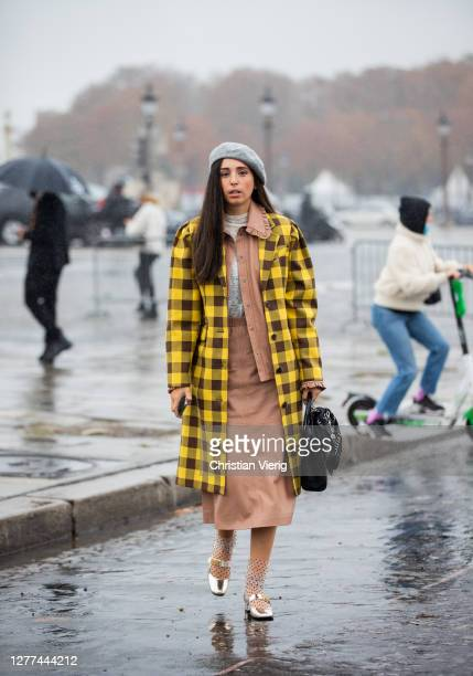 Guest is seen wearing yellow checkered jacket, beret outside Dior during Paris Fashion Week - Womenswear Spring Summer 2021 : Day Two on September...