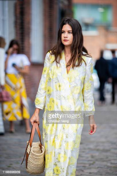 Guest is seen wearing yellow dress outside Rodebjer during Copenhagen Fashion Week Spring/Summer 2020 on August 07, 2019 in Copenhagen, Denmark.