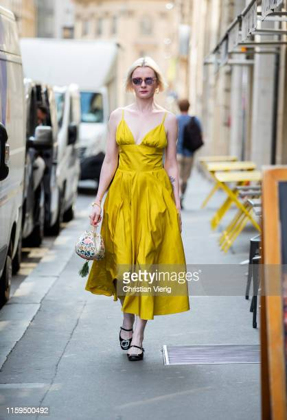 Guest is seen wearing yellow dress outside Schiaparelli during Paris Fashion Week - Haute Couture Fall/Winter 2019/2020 on July 01, 2019 in Paris,...