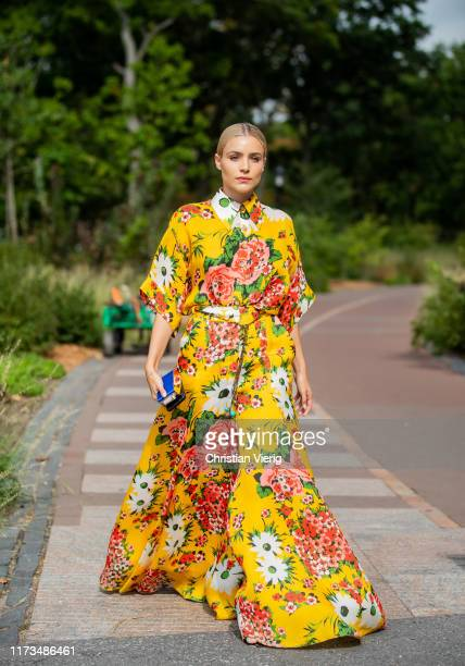 A guest is seen wearing yellow dress with floral print outside Carolina Herrera during New York Fashion Week September 2019 on September 09 2019 in...
