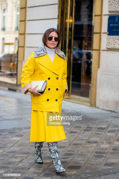 A guest is seen wearing yellow jacket and skirt outside Guy Laroche during Paris Fashion Week Womenswear Fall/Winter 2020/2021 Day Three on February...