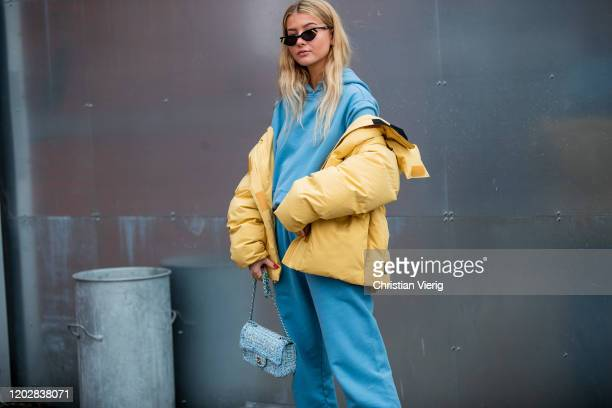 Guest is seen wearing yellow jacket, blue hoody, jogger pants outside Holzweiler during Copenhagen Fashion Week Autumn/Winter 2020 Day 2 on January...