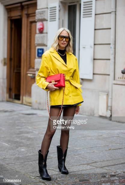 Guest is seen wearing yellow jacket, sheer tights outside Guy Laroche during Paris Fashion Week - Womenswear Fall/Winter 2020/2021 : Day Three on...