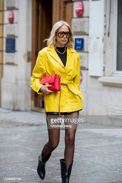 A guest is seen wearing yellow jacket sheer tights outside Guy Laroche during Paris Fashion Week Womenswear Fall/Winter 2020/2021 Day Three on...