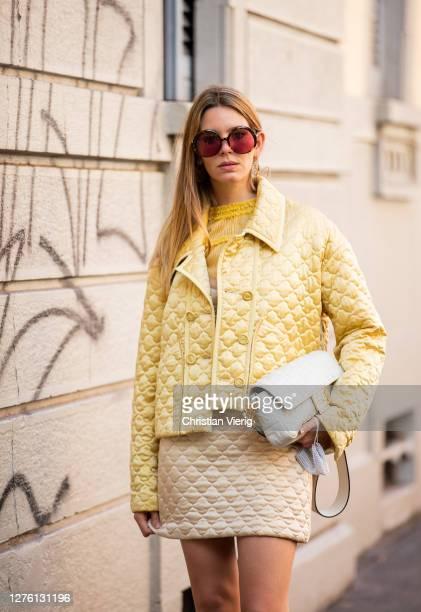 Guest is seen wearing yellow jacket, skirt, Fendi bag, boots outside Fendi during the Milan Women's Fashion Week on September 23, 2020 in Milan,...