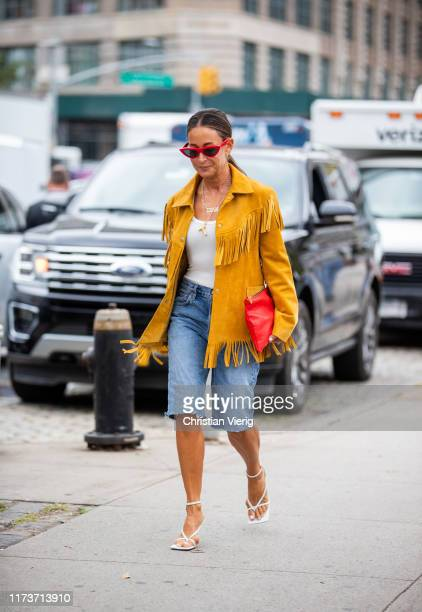 A guest is seen wearing yellow jacket with fringes denim shorts outside Sally LaPointe during New York Fashion Week September 2019 on September 10...
