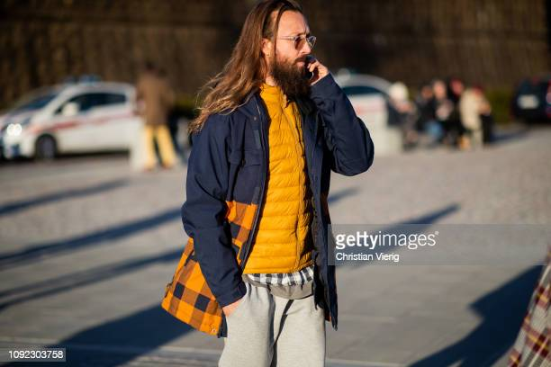 A guest is seen wearing yellow puffer jacket jacket during the 95th Pitti Uomo at Fortezza Da Basso on January 10 2019 in Florence Italy