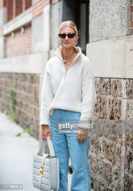 Guest is seen wearing ziped cardigan outside Issey Miyake during Paris Fashion Week Womenswear Spring Summer 2020 on September 27, 2019 in Paris,...