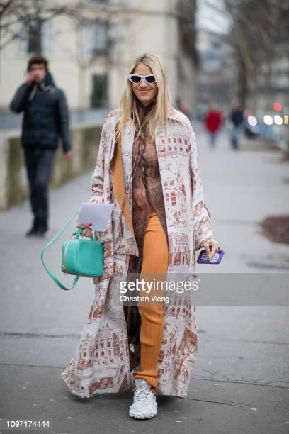 Guest is seen wearomg kimono outside Acne during Paris Fashion Week - Menswear F/W 2019-2020 Day Six on January 20, 2019 in Paris, France.