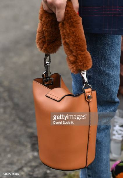 A guest is seen with a brown leather with fur bag outside the Coach show during New York Fashion Week Women's S/S 2018 on September 12 2017 in New...