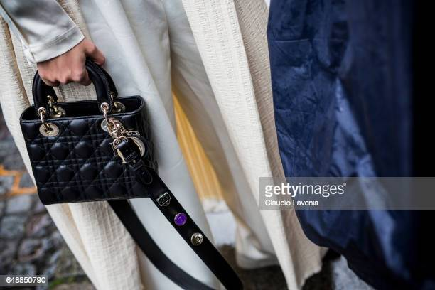 A guest is seen with a Dior bag before the Giambattista Valli show during Paris Fashion Week Womenswear Fall/Winter 2017/2018 on March 6 2017 in...
