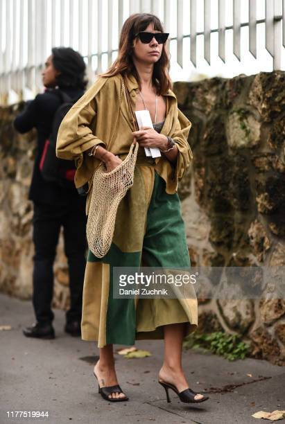 Guest is seen with a straw bag outside the Loewe show during Paris Fashion Week SS20 on September 27, 2019 in Paris, France.