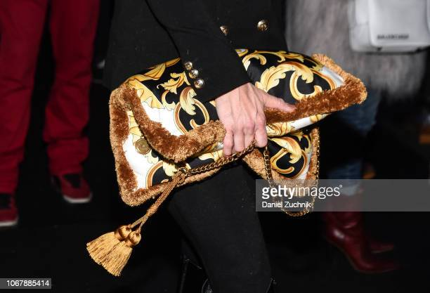 A guest is seen with a Versace bag outside the Versace PreFall 2019 Collection on December 2 2018 in New York City