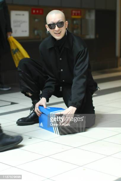 A guest is seen with adidas box during the Amazon Fashion Week TOKYO 2019 A/W on March 21 2019 in Tokyo Japan