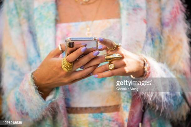 Guest is seen with phone jewelery outside Fendi during the Milan Women's Fashion Week on September 23, 2020 in Milan, Italy.