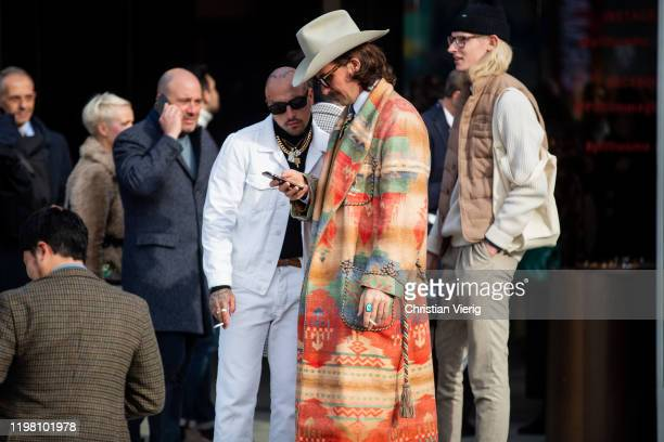 Guest is seen with tattoos wearing white jacket and pants, black turtleneck and a guest is seen wearing cowboy hat, brown suit, Ralph Lauren coat...