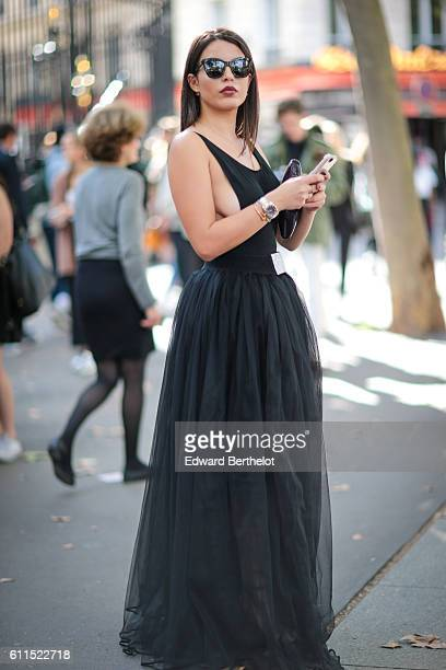 A guest is wearing a black dress outside the Balmain show at Hotel Potocki during Paris Fashion Week Spring Summer 2017 on September 29 2016 in Paris...