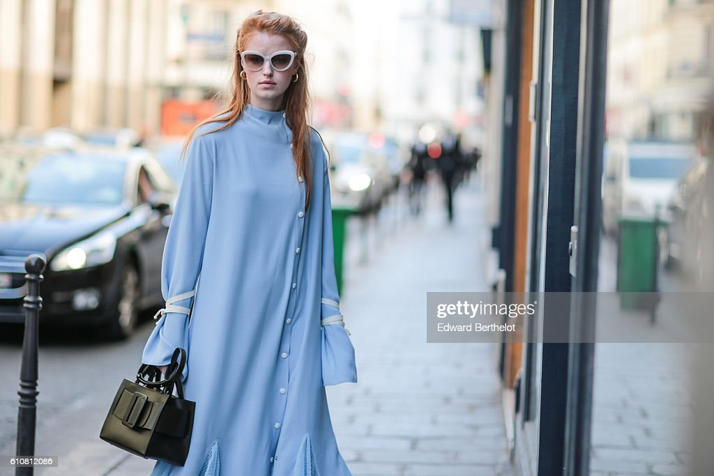 A guest is wearing a blue dress outside the Aalto show, on September 27, 2016 in Paris, France.