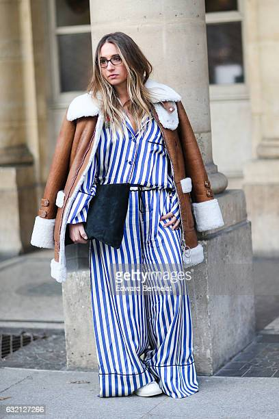 A guest is wearing a brown coat and a striped full outfit after the Louis Vuitton show during Paris Fashion Week Menswear Fall/Winter 2017/2018...