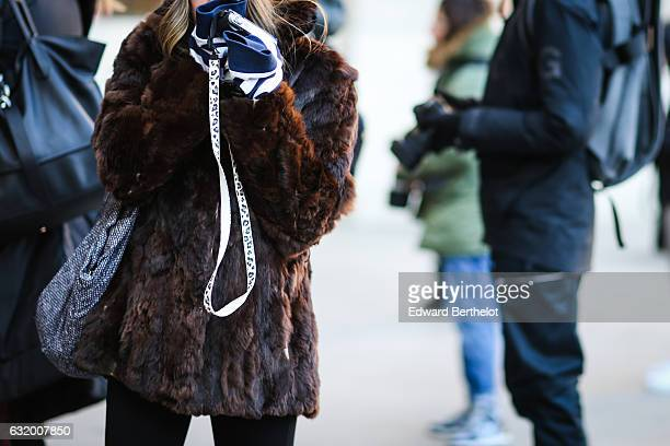 A guest is wearing a brown faux fur coat after the Balenciaga show during Paris Fashion Week Menswear Fall/Winter 2017/2018 at Place Vendome on...