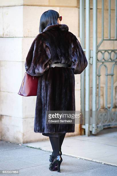 A guest is wearing a brown faux fur coat sunglasses a Prada bag and black heels after the Balenciaga show during Paris Fashion Week Menswear...