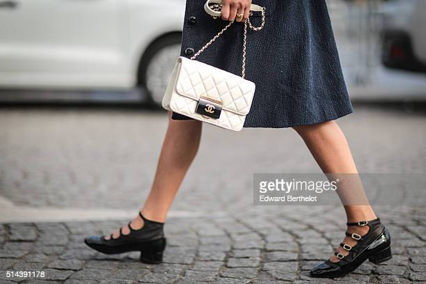 A guest is wearing a Chanel bag after the Chanel show during Paris Fashion Week Womenswear Fall Winter 2016/2017 on March 8 2016 in Paris France